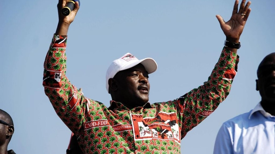 FILE - In this Thursday, June 24, 2010 file photo, Burundi's President Pierre Nkurunziza gestures to supporters during his electoral campaign in Gatumba, 20km from the capital Bujumbura, in Burundi. More than 10,000 people from the East African nation of Burundi have crossed into neighboring Rwanda amid threats of violence ahead of elections in 2015, with many arriving saying they have been intimidated by thugs who support President Pierre Nkurunziza who may seek a third term. (AP Photo / Marc Hofer, File)