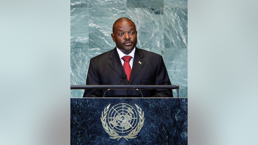 FILE - In this Friday, Sept. 23, 2011 file photo, Burundi's President Pierre Nkurunziza addresses the 66th session of the United Nations General Assembly at U.N. headquarters in New York. More than 10,000 people from the East African nation of Burundi have crossed into neighboring Rwanda amid threats of violence ahead of elections in 2015, with many arriving saying they have been intimidated by thugs who support President Pierre Nkurunziza who may seek a third term. (AP Photo/Jason DeCrow, File)