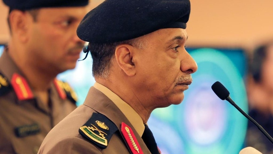 Saudi Interior Ministry spokesman Maj. Gen. Mansour al-Turki listens to journalists questions during a press conference in Riyadh, Saudi Arabia, Friday, April 24, 2015. al-Turki said a Saudi man arrested on suspicion of shooting dead two policemen and wounding two others in separate attacks in Riyadh in March and April was acting on instructions from Islamic State militants in Syria. (AP Photo/Hasan Jamali)