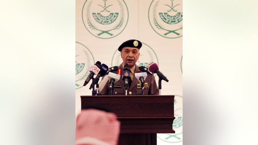 Saudi Interior Ministry spokesman Maj. Gen. Mansour al-Turki speaks during a press conference in Riyadh, Saudi Arabia, Friday, April 24, 2015. al-Turki said a Saudi man arrested on suspicion of shooting dead two policemen and wounding two others in separate attacks in Riyadh in March and April was acting on instructions from Islamic State militants in Syria. (AP Photo/Hasan Jamali)