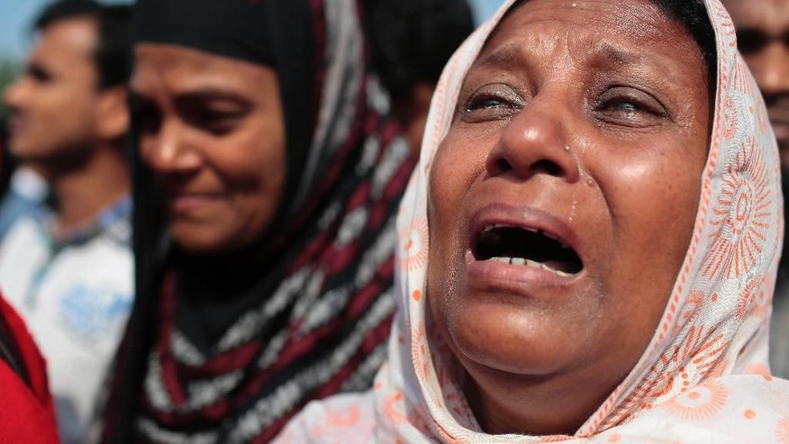 A Bangladeshi relative of a victim of the Rana Plaza garment factory collapse, mourns at the site of the accident in Savar, near Dhaka, Bangladesh, Friday, April 24, 2015. Bangladesh suffered its worst industrial disaster when Rana Plaza, an illegally built, multistoried building located outside of Dhaka, Bangladesh's capital, collapsed in 2013 killing 1,127 people and injuring about 2,500. (AP Photo/A.M. Ahad)
