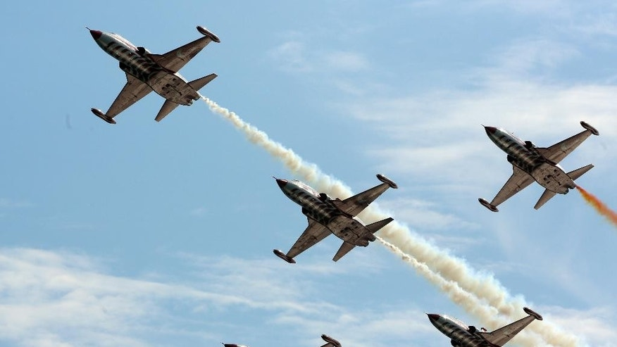 The Turkish army's aerobatic demonstration team, the Turkish Stars, perform with their supersonic jets during the Turkish International Service at Mehmetcik Abide in the Gallipoli Peninsula, Turkey, Friday, April 24, 2015. As world leaders gather with the descendants of the fighters in Gallipoli, the memories of one of the most harrowing campaigns of the 20th century have come surging back to life. The doomed Allied offensive to secure a naval route from the Mediterranean to Istanbul through the Dardanelles, and take the Ottomans out of the war, resulted in over 130,000 deaths on both sides. (AP Photo/Burhan Ozbilici)