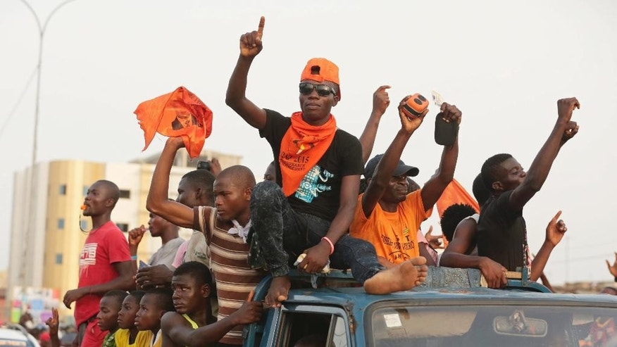 In this photo taken on Thursday, April 23, 2015, supporters of Togo opposition candidate Jean-Pierre Fabre of the National Alliance for Change party during there final election rally in Lome, Togo.  Togo residents go to the polls Saturday in a vote that could see President Faure Gnassingbe remain in power for a third five-year term. (AP Photo/Erick Kaglan)
