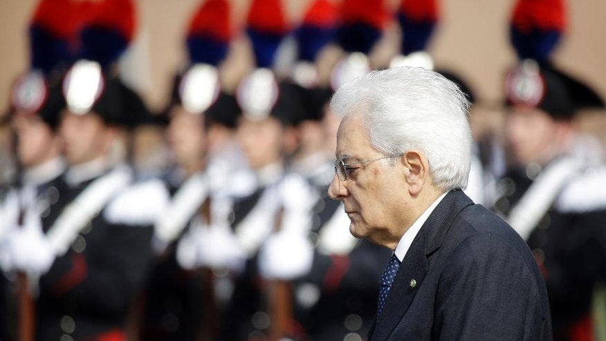Italian President Sergio Mattarella reviews the honor guard during a ceremony to mark Italy's Liberation day, in Rome Saturday, April 25, 2015. Italy is celebrating the 70th anniversary of a partisan uprising against the Nazis and their Fascist allies at the end of World War II. President Sergio Mattarella marked Liberation Day on Saturday by laying a wreath on the tomb of the unknown soldier in Rome. The anniversary marks the day in 1945 when the Italian resistance movement proclaimed an insurgency as the Allies were pushing German forces out of the peninsula. (AP Photo/Gregorio Borgia)