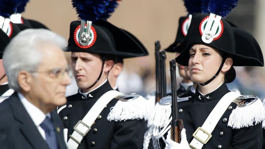 Italian President Sergio Mattarella reviews the Carabinieri honor guard during a ceremony to mark Italy's Liberation day, in Rome Saturday, April 25, 2015. Italy is celebrating the 70th anniversary of a partisan uprising against the Nazis and their Fascist allies at the end of World War II. President Sergio Mattarella marked Liberation Day on Saturday by laying a wreath on the tomb of the unknown soldier in Rome. The anniversary marks the day in 1945 when the Italian resistance movement proclaimed an insurgency as the Allies were pushing German forces out of the peninsula. (AP Photo/Gregorio Borgia)