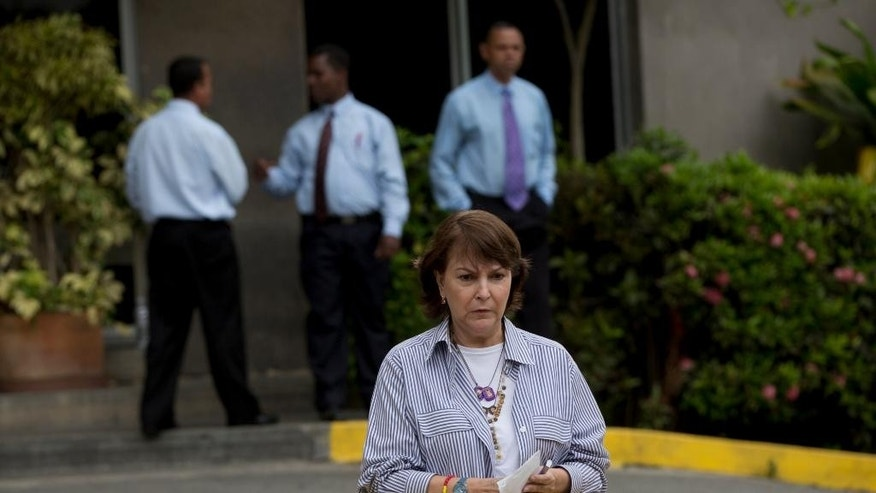 Mitzy Capriles, wife of Caracas' Mayor Antonio Ledezma, prepares to speak to the media outside of the San Roman Urology Hospital in Caracas, Venezuela, Saturday, April 25, 2015. The jailed mayor of Venezuela's capital has been taken from prison to the hospital where he will undergo emergency surgery for a groin hernia. Ledezma was transferred early Saturday after a court granted prosecutors' request to permit his release on medical grounds, according to his lawyer Omar Estacio. (AP Photo/Fernando Llano)