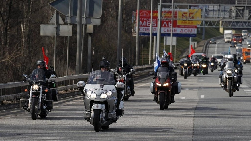 A group of Russian bikers rides leaving Moscow, Saturday, April 25, 2015, as they begin run to Germany to mark the 70th anniversary of Soviet victory over Nazi Germany. Riders from a Russian nationalist motorcycle group have begun their run commemorating the Red Army's offensive against Nazi Germany, despite Poland's announcement that it would refuse to let them in the country. About 20 bikers including members of the Night Wolves group set off from Moscow Saturday, with the aim of crossing into Poland before eventually reaching Berlin on May 9. (AP Photo/Alexander Zemlianichenko)