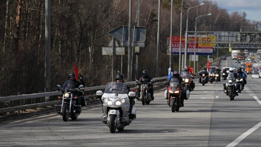 A group of Russian bikers rides leaving Moscow, Saturday, April 25, 2015, as they begin trip to Germany to mark the 70th anniversary of Soviet victory over Nazi Germany. Riders from a Russian nationalist motorcycle group have begun their run commemorating the Red Army's offensive against Nazi Germany, despite Poland's announcement that it would refuse to let them in the country. About 20 bikers including members of the Night Wolves group set off from Moscow Saturday, with the aim of crossing into Poland before eventually reaching Berlin on May 9. (AP Photo/Alexander Zemlianichenko)