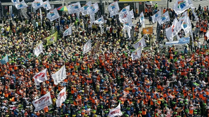 Members of Korean Confederation of Trade Unions and members of labor union of state employees perform during a rally against the government labor policy in front of the Seoul City Hall in Seoul, South Korea, Saturday, April 25, 2015. Thousands of South Koreans marched in Seoul for the second straight day Saturday to protest government labor policies and the handling of a ferry disaster that killed more than 300 people a year ago. (AP Photo/Lee Jin-man)