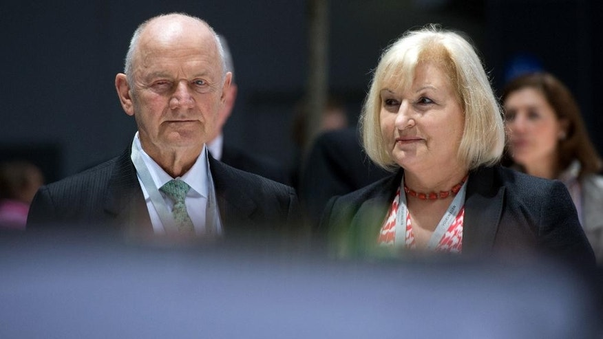 FILE - In this April 25, 2013 file photo Chairman of the board of Volkswagen AG Ferdinand Piech and his wife Ursula Piech, member of the board, arrive for a meeting of Volkswagen AG in Hannover, northern Germany. Piech and his wife will step back from their posts as Volkswagen announced on Saturday, April 25, 2015. (Julian Stratenschulte/dpa via AP, File)