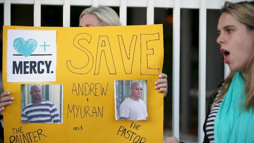 Demonstrators gather at the Indonesian consulate in Sydney, Monday, April 27, 2015, as they protest the pending execution of two Australians on death row in Indonesia. Australian leaders continued to lobby Indonesia to spare the lives of drug traffickers Myuran Sukumaran, 33, and Andrew Chan, 31, facing execution by an Indonesian firing squad. (AP Photo/Rick Rycroft)