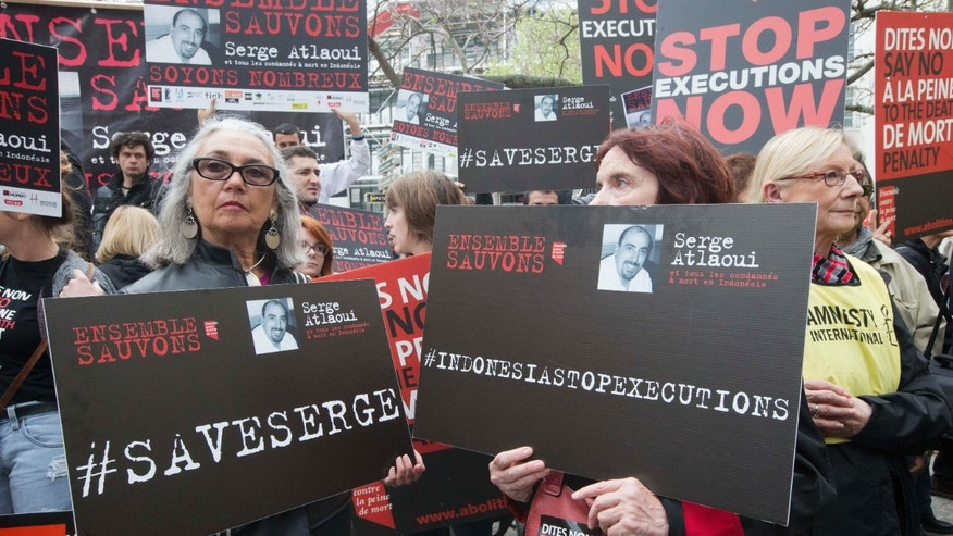 "April 25, 2015: Protesters hold placards including one reading ""Let's save Serge Altlaoui"" in Paris."