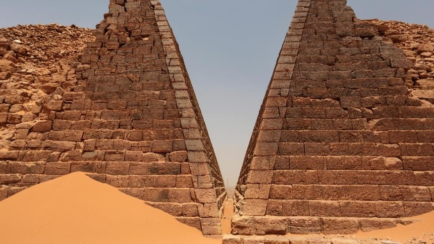 In this Thursday, April 16, 2015 photo, a view of the historic Meroe pyramids in al-Bagrawiya, 200 kilometers (125 miles) north of Khartoum, Sudan. The site once served as the principle residence of the rulers of the Kush kingdom, known as the Black Pharaohs. Their pyramids, ranging from 6-meters (20-feet) to 30-meters (100-feet) tall, are some 4,600 years old. (AP Photo/Mosa'ab Elshamy)