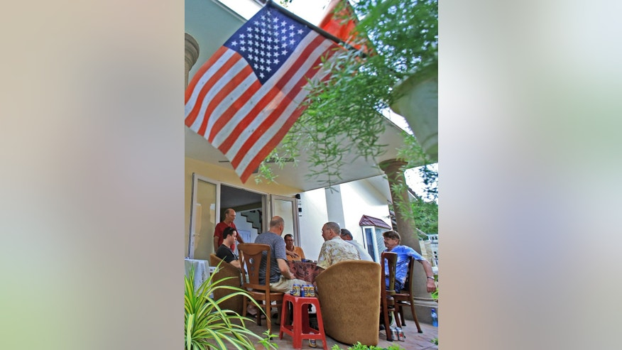 In this April 11, 2015, photo, a group of American Vietnam war veterans play poker at the house of Bill Ervin, a former U.S. Marine from Colorado, in Danang, Vietnam. The presence of American war veterans in today's Vietnam - and the warm welcome they usually receive - is yet another sign of how much the U.S.-Vietnamese relationship has evolved since the countries normalized relations in 1995. (AP Photo/Hau Dinh)