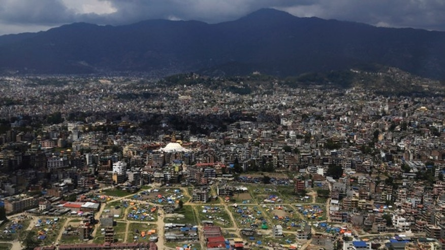 An aerial view of tents setup by residents in Kathmandu, Nepal, Monday, April 27, 2015. Shelter, fuel, food, medicine, power, news, workers â Nepal's earthquake-hit capital was short on everything Monday as its people searched for lost loved ones, sorted through rubble for their belongings and struggled to provide for their families' needs. (AP Photo/Altaf Qadri)