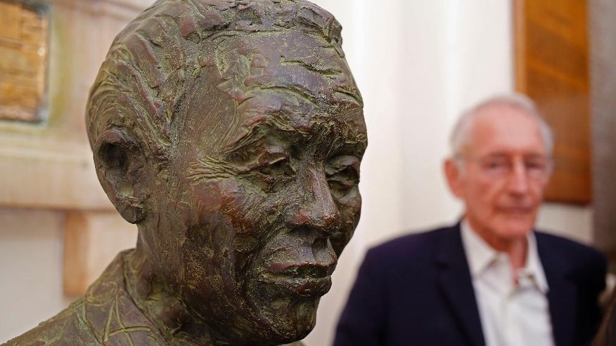 A statue of former South African president Nelson Mandela,  by sculptor Bill Davis, background is unveiled at Cape Town City Hall where Mandela made his first speech after  his release from prison, in Cape Town, South Africa,  Monday, April 27, 2015. The crisis made for a circumspect mood on Monday, a national holiday, as South Africa marked the 21st anniversary of its first all-race elections on April 27, 1994, in which Nelson Mandela was elected as the nation's first black president at the end of apartheid. (AP Photo/Schalk van Zuydam)