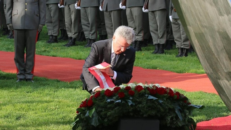Austrian President Heinz Fischer lays a wreath in front of the National Foundation Memorial in Vienna, Austria, Monday, April 27, 2015. The Second Republic of Austria was established 70 years ago. (AP Photo/Ronald Zak)