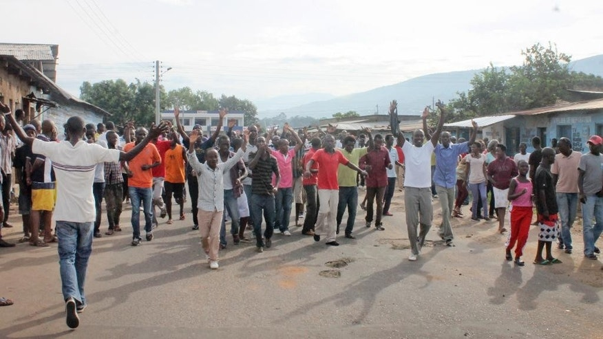 Opposition supporters protest in the capital Bujumbura, Burundi Monday, April 27, 2015. Street protests continued Monday in Burundi as anger mounts over the ruling party's decision on Saturday to nominate President Pierre Nkurunziza for a third term. (AP Photo/Eloge Willy Kaneza)