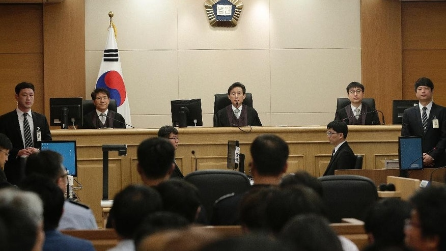 Judges sit to preside over verdicts for the sunken South Korean ferry Sewol's crew members who are charged with negligence and abandonment of passengers in the disaster at Gwangju High Court in Gwangju, South Korea, Tuesday, April 28, 2015.  The South Korean appellate court on Tuesday handed down a sentence of life in prison to the captain of a ferry that sank last year, killing more than 300 people. The sentencing is harsher than a November verdict by a district court that sentenced Lee Joon-seok to 36 years in prison for negligence and abandoning passengers in need.  (AP Photo/Ahn Young-joon, Pool)