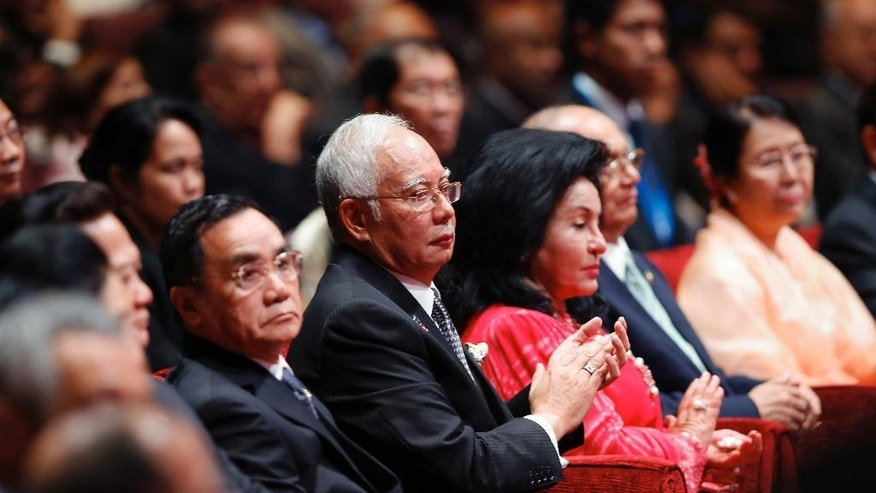 Malaysia's Prime Minister Najib Razak, fourth right, and Laos's Prime Minister Thongsing Thammavong, fifth right, attend the opening ceremony for the 26th ASEAN Summit in Kuala Lumpur, Malaysia, on Monday, April 27, 2015. (AP Photo/Vincent Thian)