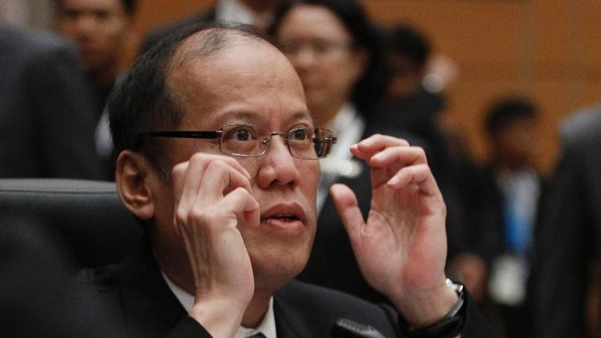 Philippine's President Benigno Aquino III gestures before the plenary session of the 26th ASEAN Summit in Kuala Lumpur, Malaysia, Monday, April 27, 2015. (AP Photo/Joshua Paul)