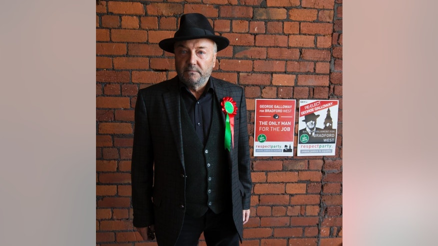 In this photo taken on Wednesday, April 22, 2015,  Respect Party Leader George Galloway poses for a picture after an interview at his offices in the constituency of Bradford West, in Bradford, England,  as Britain's political parties campaign in the lead up to the parliamentary elections on May 7.  Anyone who thinks Britain's election is dull hasn't been to Bradford West, the campaign's wildest race, where debate ranges from local schools and services to the Israeli-Palestinian conflict, and noble rhetoric collides with character attacks. (AP Photo/Jon Super)