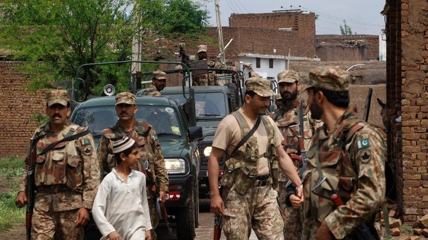 Pakistani troops arrive to help victims from Sunday evening's heavy rain and windstorm that reached up to a speed of 120 kph (75 mph) which collapsed hundreds of buildings, uprooted trees, and electric poles, in Peshawar, Pakistan, Monday, April 27, 2015. Officials say death toll has risen to at least 44. (AP Photo/Mohammad Sajjad)