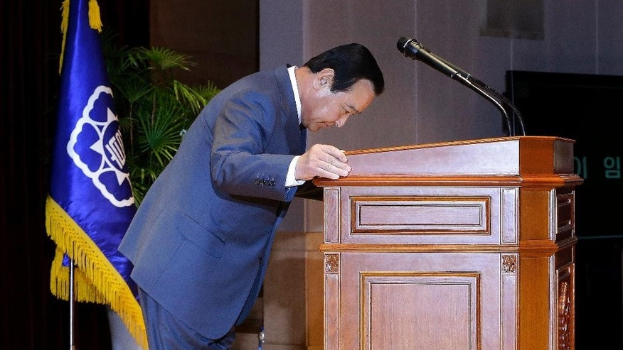 South Korean Prime Minister Lee Wan Koo bows during his farewell ceremony at the Central Government Complex in Seoul, South Korea Monday, April 27, 2015. South Korean President Park Geun-hye on Monday accepted the resignation offer by her prime minister over a bribery scandal. (AP Photo/Ahn Young-joon)