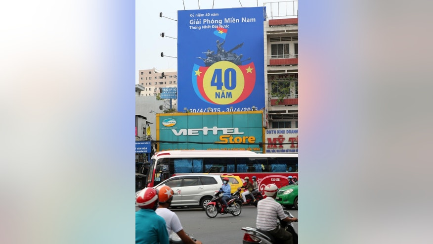 In this photo taken April 20, 2015, a poster for the 40th anniversary of the end of the Vietnam War is displayed on a Viettel store, a cellphone operator, in Ho Chi Minh City, Vietnam. Viettel, a military enterprise, earned nearly $2 billion in pre-tax profits last year, or 85 percent of all profits reported by military enterprises, the state-run Zing News quoted the companys general director, Nguyen Manh Hung, as saying in January. Viettel has also expanded to nine markets across Asia, Africa and Latin America. (AP Photo/Na Son Nguyen)