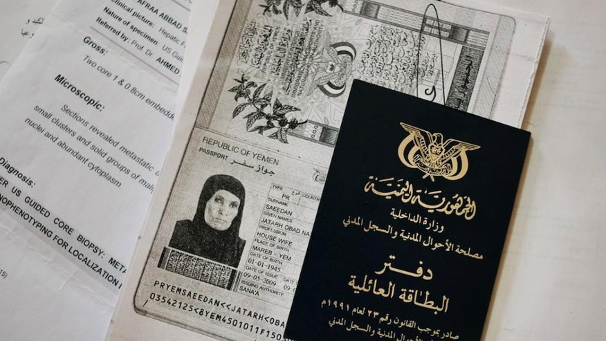 This Tuesday, April 21, 2015 photo shows, travel documents and medical statements of Yemeni housewife, Jatarh Obad at an apartment in Cairo, Egypt. As a Shiite rebel offensive and Saudi-led airstrikes rage on in Yemen, thousands of Yemenis remain stuck in Egypt, unable to return home. (AP Photo/Alex Potter)