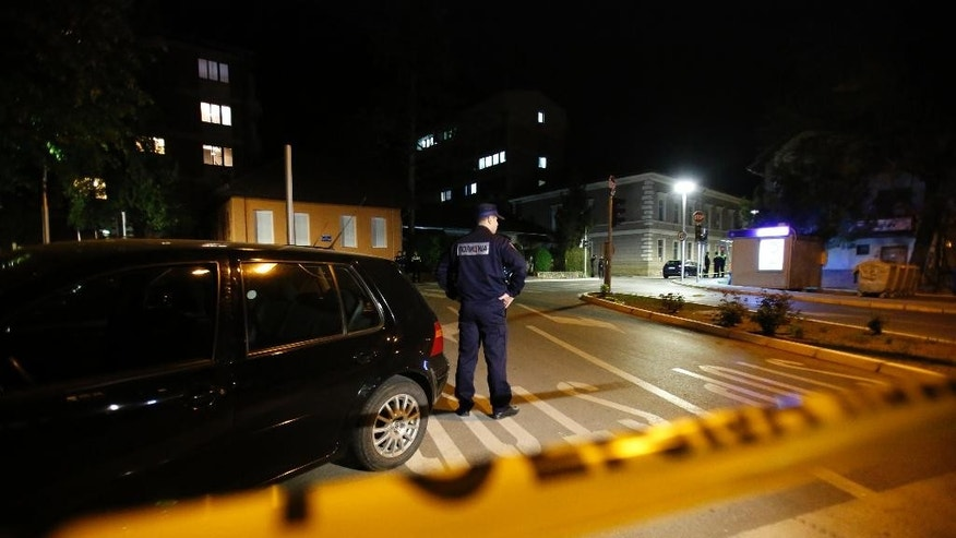 """Police officers secure the area near to a police station following a shooting incident in the eastern Bosnian town of Zvornik, 200 Km (124 miles) east of Sarajevo, on Monday, April 27, 2015. Bosnian authorities say a man stormed into a police station in a northeastern town of Zvornik shouting """"Allahu akbar,"""" killing a policeman and wounding two others, according to Police spokeswoman Aleksandra Simojlovic, who confirmed to The Associated Press that the attacker was killed.(AP Photo/Amel Emric)"""