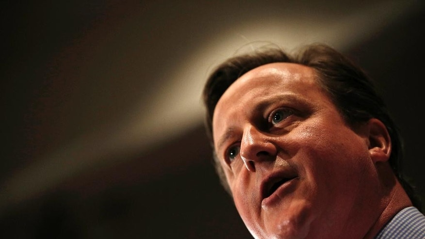 Britain's Prime Minister and leader of the Conservative Party, David Cameron, gives a speech during his general election campaign visit at the Institute of Chartered Accountants in London on Monday April 27, 2015.  Britain goes to the polls on May 7 to elect a new parliament. (Adrian Dennis/Pool Photo via AP)