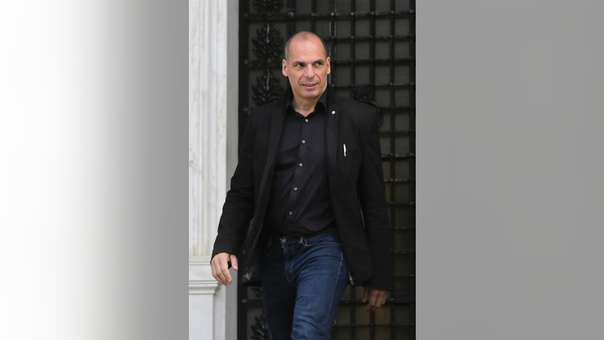 Greek Finance Minister Yanis Varoufakis leaves from a meeting with Greek Prime Minister in Athens, on Tuesday, April 28, 2015.  Varoufakis, who has come under fire from his European peers for dragging his feet in the bailout talks, continued to enjoy the government's support. He will continue to lead the negotiations with the help of Euclid Tsakalotos, who is minister of international financial relations and part of the foreign ministry.(AP Photo/Petros Giannakouris)