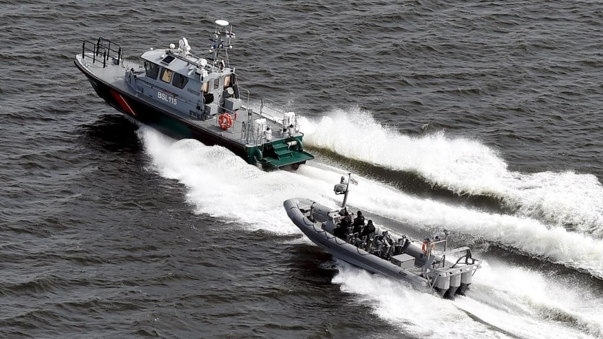 Boats of the Finnish Border Guard patrol the waters outside Helsinki Tuesday, April 28, 2015. The Finnish military said  it has dropped depth charges onto a suspected submarine in the sea outside Helsinki after twice detecting the presence of a foreign object in the area. (Jussi Nukari/LEHTIKUVA  via AP) FINLAND OUT