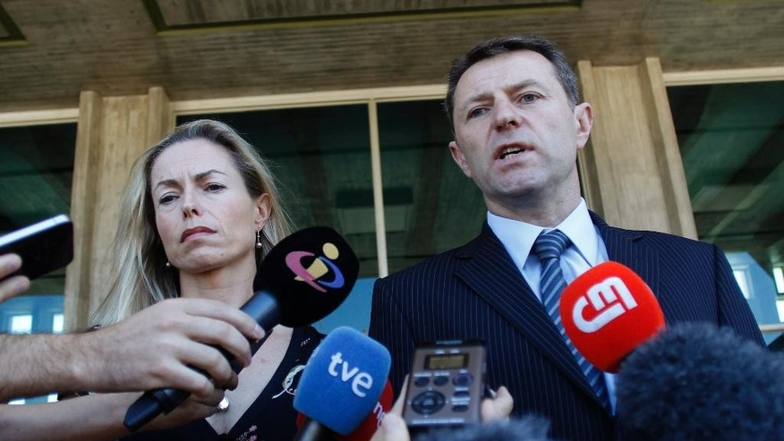 July 8, 2014: Kate McCann, left, and Gerry McCann, the parents of missing British girl Madeleine McCann, talk to the media outside a court in Lisbon.