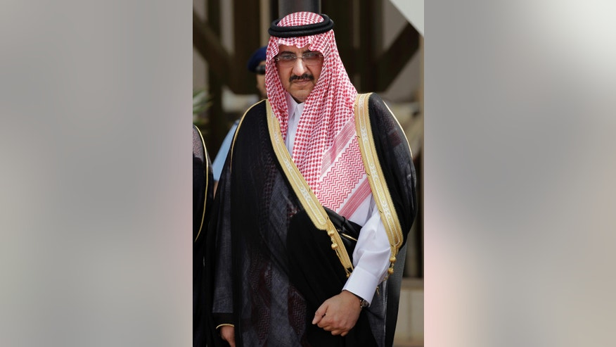 FILE- In this May 14, 2012 file photo, Saudi Arabia's Interior Minister Prince Mohammed bin Nayef waits for Gulf Arab leaders ahead of the opening of Gulf Cooperation Council, also known as GCC summit, in Riyadh, Saudi Arabia. Saudi Arabia's King Salman on Wednesday, April 29, 2015 removed his half-brother from the post of crown prince and named his nephew, the country's Interior Minister, in his place. The post of crown prince secures Prince Mohammed bin Nayef as the most likely successor to King Salman. (AP Photo/Hassan Ammar, File)