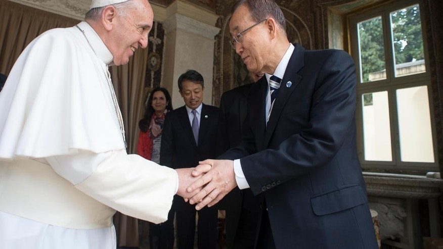 "Pope Francis shakes hands with U.N. Secretary-General Ban Ki-moon during their meeting at the Vatican, Tuesday, April 28, 2015. The U.N. chief praised Pope Francis on Tuesday for framing climate change as an urgent moral imperative, saying his upcoming encyclical combined with a new round of U.N. climate talks in Paris provide an ""unprecedented opportunity"" to create a more sustainable future for the planet. (AP Photo/L'Osservatore Romano/Pool Photo via AP)"