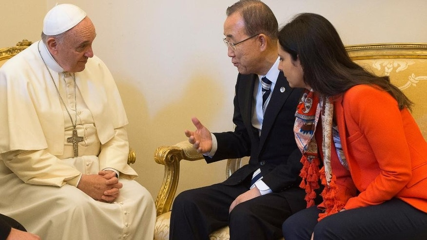"Pope Francis meets with U.N. Secretary-General Ban Ki-moon at the Vatican, Tuesday, April 28, 2015. The U.N. chief praised Pope Francis on Tuesday for framing climate change as an urgent moral imperative, saying his upcoming encyclical combined with a new round of U.N. climate talks in Paris provide an ""unprecedented opportunity"" to create a more sustainable future for the planet. (AP Photo/L'Osservatore Romano/Pool Photo via AP)"