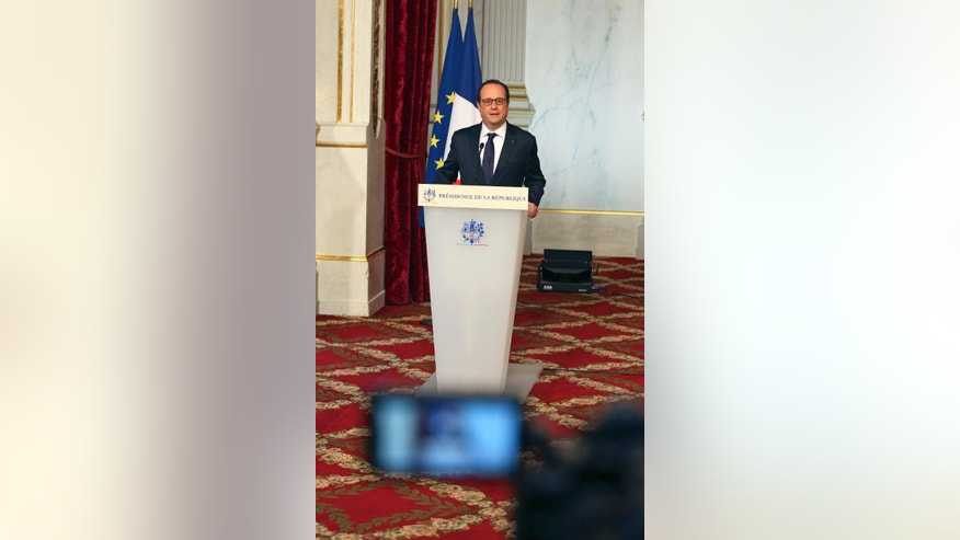 French President Francois Hollande gives a statement following a defense meeting at the Elysee Palace in Paris Wednesday, April 29, 2015. Hollande decided to increase the military budget by 3,8 billion euro ($4,2 billion) by 2019 to allow troops to fulfill anti-terror mission. (AP Photo/Remy de la Mauviniere)