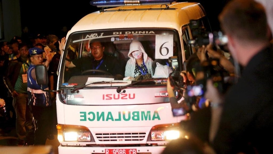 An ambulance arrives from the prison island of Nusakambangan where the executions were carried out, in Cilacap, Central Java, Indonesia, Wednesday, April 29, 2015. Indonesia brushed aside last-minute appeals and executed eight people convicted of drug smuggling on Wednesday, although a Philippine woman was granted a stay of execution. (AP Photo/Tatan Syuflana)