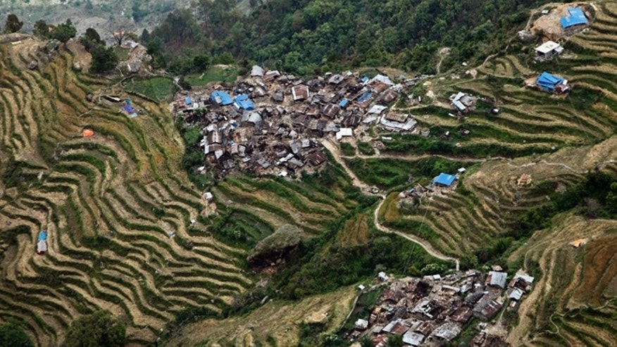 Destroyed villages sit on mountain tops near the epicenter of Saturday's massive earthquake, in the Gorkha District of Nepal, Wednesday, April 29, 2015. Aid reached a hilly district near the epicenter of Nepal's earthquake for the first time Wednesday, four days after the quake struck. (AP Photo/Wally Santana)