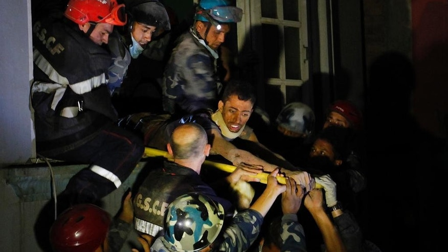 April 28, 2015: Survivor Rishi Khanal, 27, is freed by French rescuers from the ruins of a three-story hotel in the Gangabu area of Kathmandu, Nepal. Across central Nepal, including in Kathmandu, the capital, hundreds of thousands of people are still living in the open without clean water or sanitation since Saturday's massive earthquake, one of the worst to hit the South Asian nation in more than 80 years.