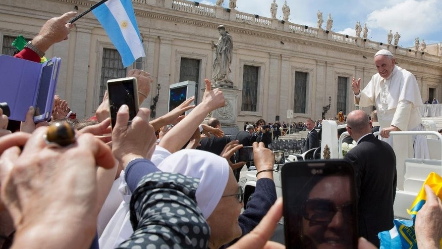 Pope Francis is cheered by faithful as he leaves St. Peter's Square at the end of the weekly general audience at the Vatican, Wednesday, April 29, 2015. (AP Photo/Alessandra Tarantino)