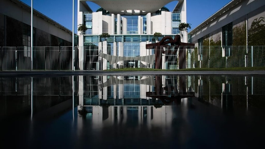 "The chancellery is reflected in a puddle in Berlin, Germany, Wednesday, April 29, 2015, where Germany's intelligence services are coordinated. Germany's top security official has asked to appear before lawmakers to respond to claims they were misled about what the government knew of U.S. spy activity in Europe. Interior Minister Thomas de Maiziere, who helped oversee Germany's foreign intelligence agency from 2005-2009, said Wednesday the allegations were untrue and he wanted to clarify them ""as quickly as possible."" (AP Photo/Markus Schreiber)"