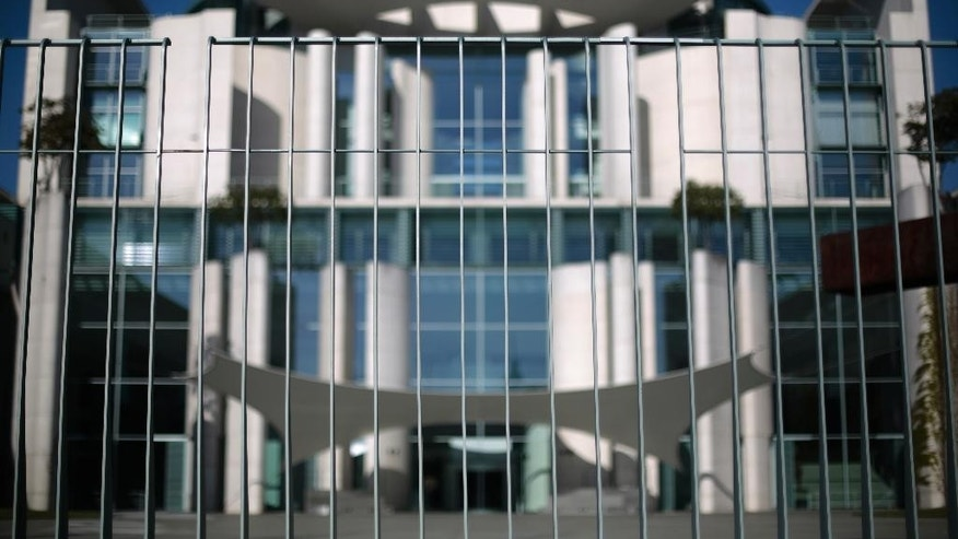 "The German chancellery is photographed behind its security fence in Berlin, Germany, Wednesday, April 29, 2015, where Germany's intelligence services are coordinated. Germany's top security official has asked to appear before lawmakers to respond to claims they were misled about what the government knew of U.S. spy activity in Europe. Interior Minister Thomas de Maiziere, who helped oversee Germany's foreign intelligence agency from 2005-2009, said Wednesday the allegations were untrue and he wanted to clarify them ""as quickly as possible."" (AP Photo/Markus Schreiber)"