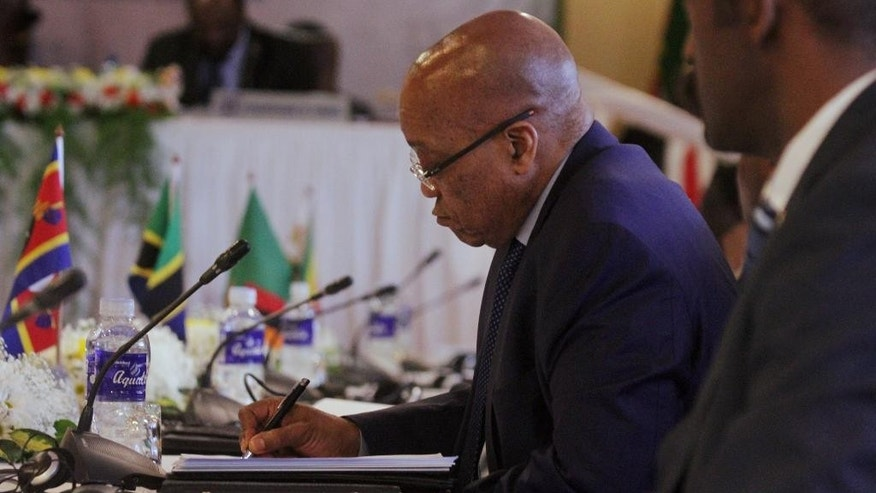 South African President Jacob Zuma attends the Southern African Development Community(SADC) Heads of State and Government Extraordinary Summit on Industrialisation in Harare, Wednesday, April, 29, 2015.The summit was called by heads of state in an effort to craft a strategy for industrialisation in the region through value addition and beneficiation of abundant natural resources in Africa. ( AP Photo/Tsvangirayi Mukwazhi)