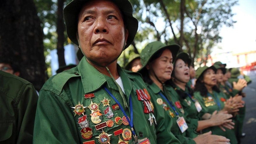 Vietnamese veterans gather for a parade celebrating the 40th anniversary of the end of the Vietnam War which is also remembered as the fall of Saigon, in Ho Chi Minh City, Vietnam, Thursday, April 30, 2015. (AP Photo/Na Son Nguyen)