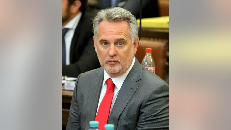 Ukrainian oligarch Dmytro Firtash waits for the start of his trial at the main court in Vienna, Austria, Thursday, April 30, 2015. Firtash was arrested in Vienna in March 2014 on an American warrant charging him with bribery and other offenses. (AP Photo/Ronald Zak)