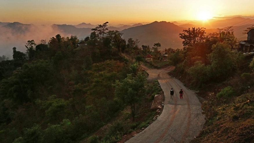 In this April 28, 2015, file photo, the sun sets over Paslang village near the epicenter of Saturday's massive earthquake in the Gorkha district of Nepal. Even amid the misery, with no running water, no electricity, and anger and frustration boiling over it's still possible to find examples of the picture postcard image of Nepal many foreigners hold in their imaginations. People here have long seen their struggles with poverty, corruption and infrastructure failures, and with a political fecklessness almost Shakespearean in scale, overshadowed by the beauty of the land and its firm place in the collective popular romantic imagination. (AP Photo/Wally Santana, File)
