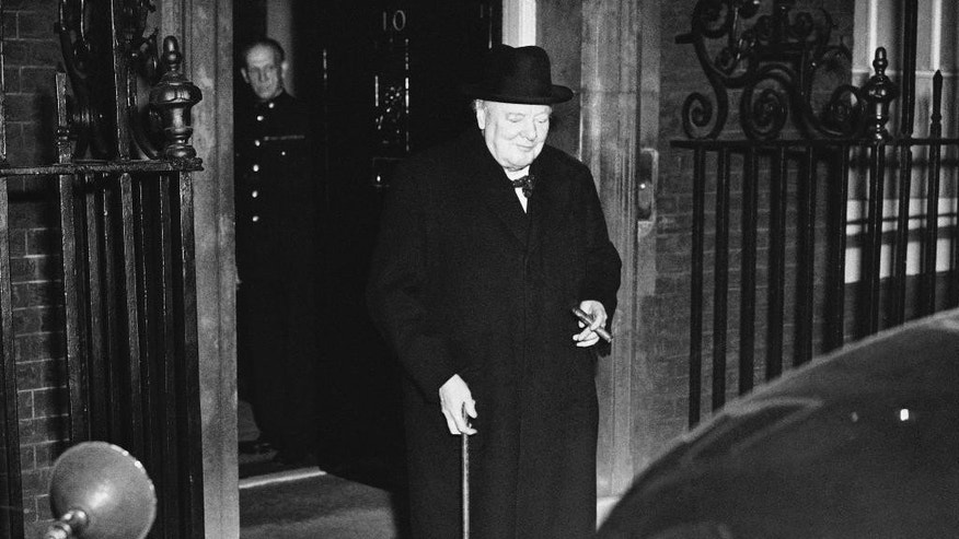 FILE - This is an Oct. 30, 1951 file photo of British Prime Minister Winston Churchill, as he leaves No. 10 Downing Street at the end of the first meeting of his new cabinet in London. At nearly 77, Churchill became the second-oldest prime minister in British history after the Conservative Party won the 1951 election. His second term as premier was dominated by foreign affairs, notably the break-up of the British Empire. Churchill would remain in post until 1955 when he resigned due to ill health.  (AP Photo, File)